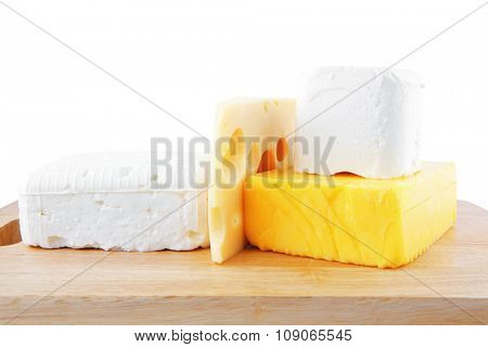 image of delicious cheeses served on wooden board