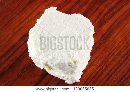 whole white light feta cheese on dishware