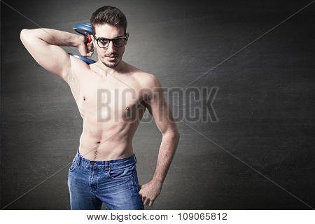 Naked nerd guy raising Heavy weights