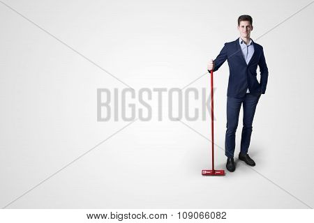 business man cleaning with mop.