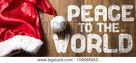 Peace to the World written on wooden with Santa Hat