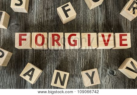 Wooden Blocks with the text: Forgive