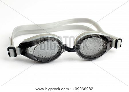 Goggles For Diving  In Water Droplets On White Background