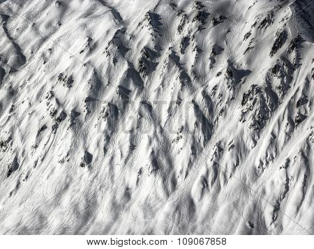 Snow traces of skiers on a mountain