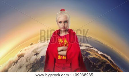 Little girl in masquerade costume standing over the Earth background