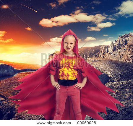 Angry girl in superhero costume in mountains
