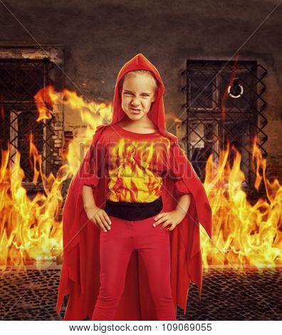 Angry girl in superhero costume in burning room