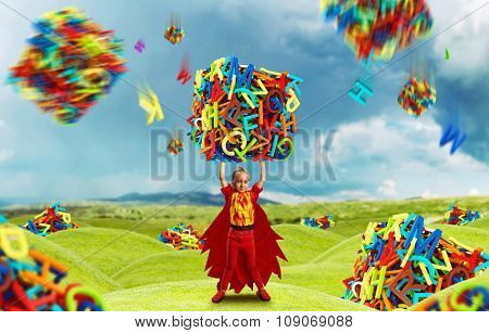 Little girl in costume holding a big cube of multicolored letters