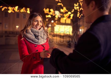 Happy young woman  receives a present from her boyfriend, present for Christmas