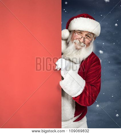 Santa Claus holding red blank sign, Christmas advertising