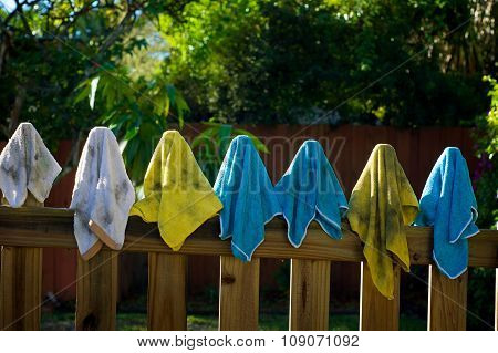 Dirty Rags Hanging On Fence