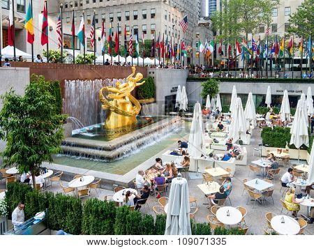 NEW YORK,USA - AUGUST 14,2015 : Lower Plaza at the Rockefeller Center with the golden statue of Prometheus in midtown Manhattan