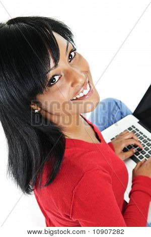 Young Black Woman Using Laptop Computer