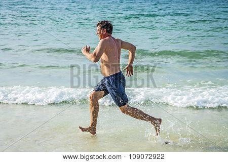 Man Runs Along The Beautiful Beach,