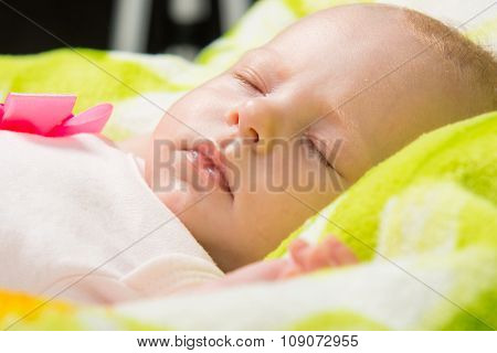 Close-up Of A Sleeping Baby In The Crib