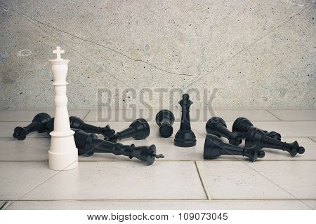 Victory Concept With White Chess King And Black Pawns On The Floor