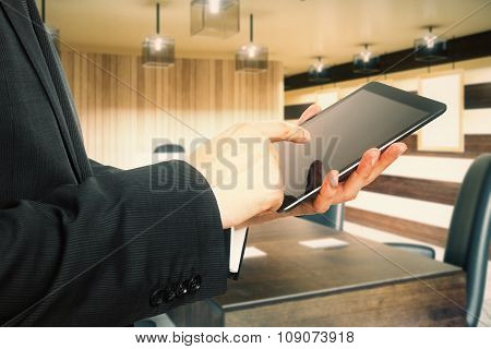 Businessman Working With Digital Tablet In Modern Wood Style Office
