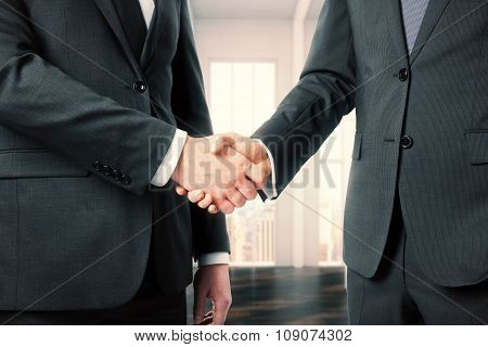 Business Partners Shake Their Hands In Office