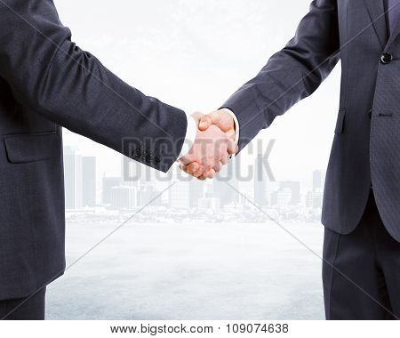 Business Partners Shake Hands At City Background