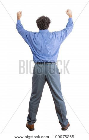 Rear View Of A Businessman Raising His Fists