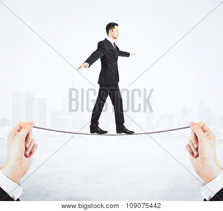 Hard Way To Success Concept With Man Walking On The Rope At City Background