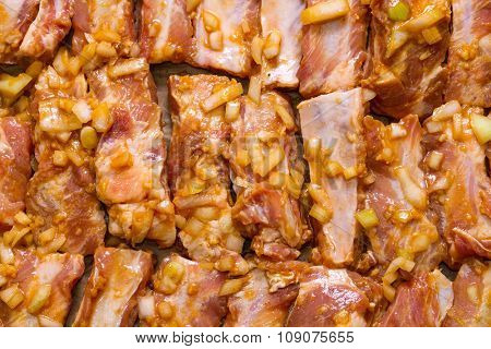 Marinated pork ribs ready for roasting. Step on step recipe.