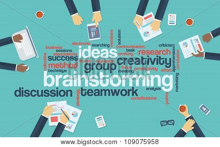 Brainstorming word tag cloud with keywords and business hands around table. Business background crea