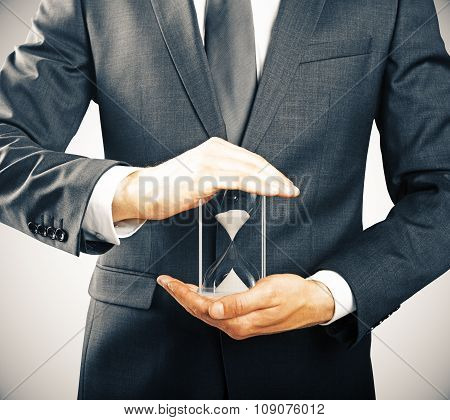 Businessman Holding Hourglass, Time Concept
