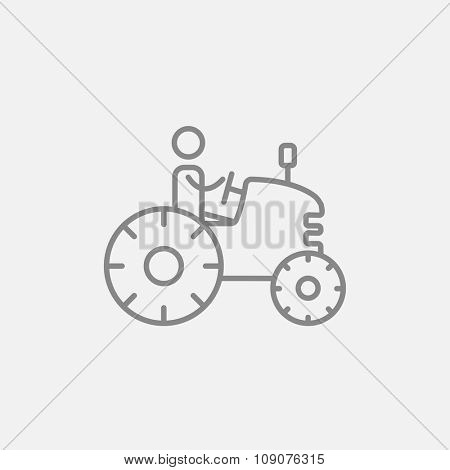 Man driving a tractor line icon for web, mobile and infographics. Vector dark grey icon isolated on light grey background.