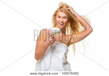 Young blond woman with blue eyes in towel dries hair