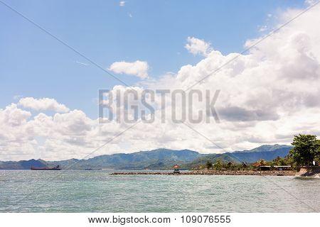 Coast Of Bali - Sea, Palms And Bungalow. Bali Island, Indonesia.