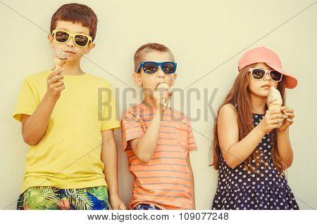 Kids Boys And Little Girl Eating Ice Cream.