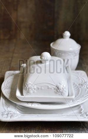 Set Of Ceramic Tableware In White Color.