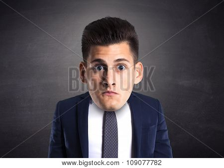 funny picture of amazed man with big head over dark background