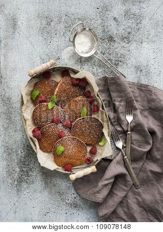 Breakfast set. Homemade buckwheat pancakes with fresh raspberry in  serving tray, kitchen napkin, vi
