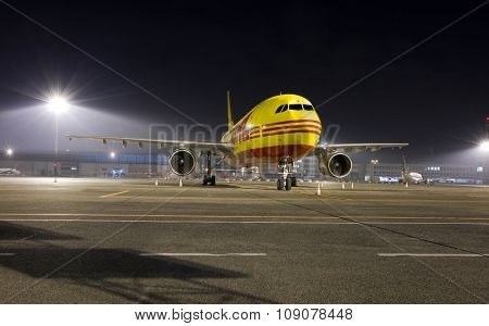 BUDAPEST, HUNGARY - MARCH 5: DHL Airbus A300 cargo plane at Budapest Airport, March 5th 2014. DHL is a world market leader in air mail