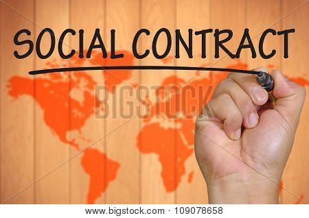 Hand Writing Social Contract Over Blur World Background