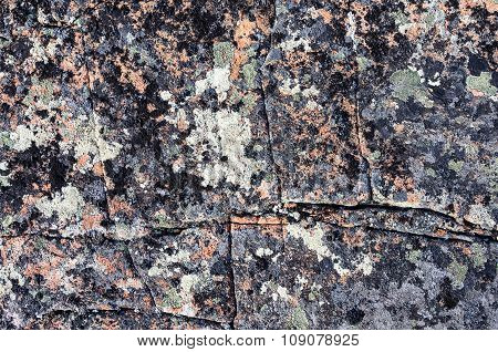 Detail Of Cracked Rocks Covered With Lichen