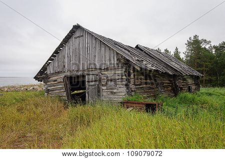 Old Abandoned Barn Log Cabin On The Beach