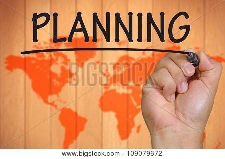 Hand Writing Planning Over Blur World Background