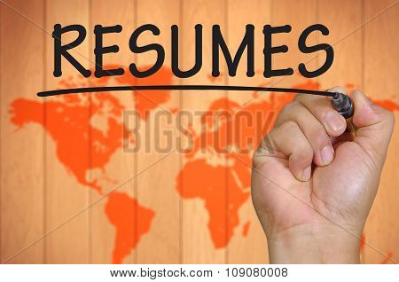 Hand Writing Resumes  Over Blur World Background