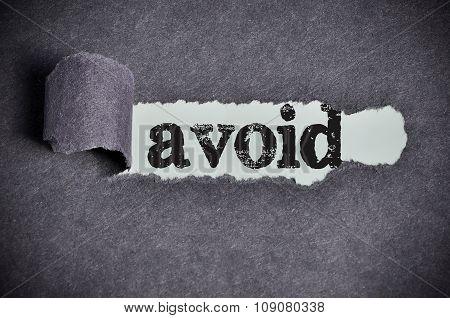 Avoid Word Under Torn Black Sugar Paper