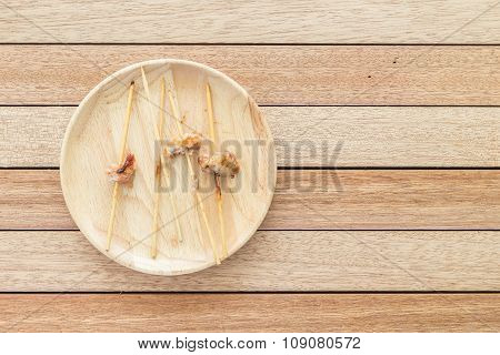 Empy Bamboo Stick Of Grilled Pork On Wooden Dish
