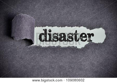 Disaster Word Under Torn Black Sugar Paper