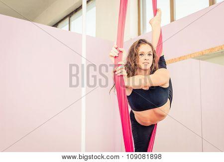 Athlete Making Gymnastic On The Elastics