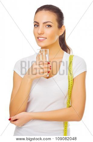 Young smiling girl with water glass isolated