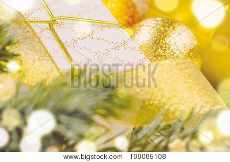 decorative christmas gift boxes and balls on white surface, macro
