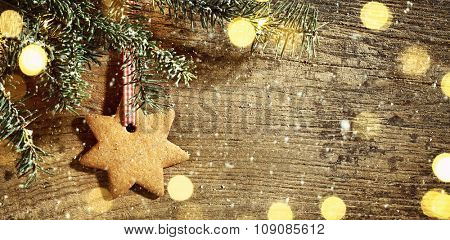 Christmas tree with cookie hanging over wooden background