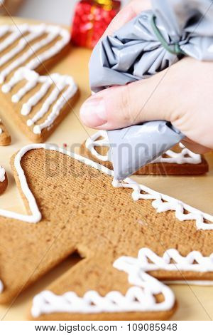 Decorating gingerbread cookies.