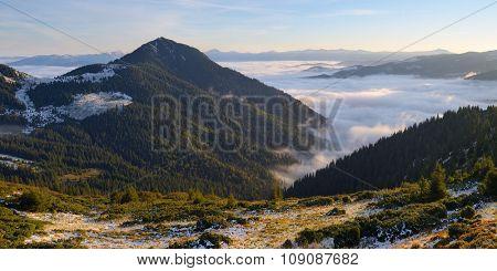 Mountain landscape. Sunny morning. First snow fall. Carpathians, Ukraine, Europe